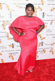 Danielle Brooks cut a regal figure in a caped magenta gown during the Fragrance Foundation Awards.