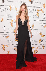 Behati Prinsloo made a seductive statement on the Fragrance Foundation Awards red carpet in a black J. Mendel slip dress with a sheer skirt underlay.