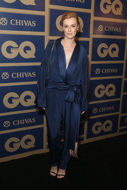 Gracie Otto stepped out in a robe-inspired satin blue jumpsuit with a cinched belt and deep V-neck