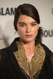 Crystal Renn attended the Glamour Women of the Year Awards wearing her hair in a side pony.