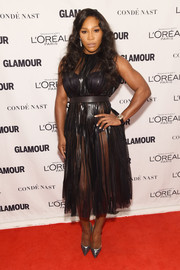 Serena Williams looked super seductive in a see-through black Gucci dress at the Glamour Women of the Year Awards. Definitely not your standard LBD!