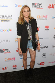 Diane Kruger attended the Global Citizen Festival rocking an oversized blazer, striped shirt, and denim shorts combo.