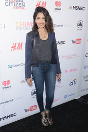 Freida Pinto was casual-edgy in a two-tone leather-panel jacket layered over a gray shirt at the Global Citizen Festival.