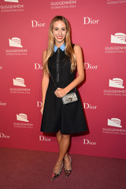 Harley Viera-Newton styled her dress with pointy silver ankle-strap pumps.
