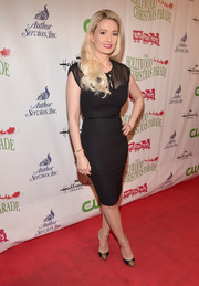 Holly Madison wore a figure-hugging black dress with a sheer top to the 2015 Hollywood Christmas Parade
