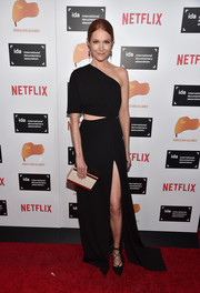 Darby Stanchfield finished off her ensemble with an elegant studded box clutch.