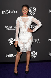 Regina Hall was a temptress in a sheer white cocktail dress at the InStyle and Warner Bros. Golden Globes party.