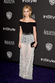Nicola Peltz oozed major sultriness in a black-and-white off-the-shoulder, sheer-skirt gown by Balenciaga at the InStyle and Warner Bros. Golden Globes party.