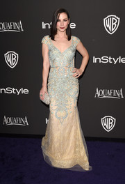 Heather McComb made a regal fashion statement at the InStyle and Warner Bros. Golden Globes party with this Mac Duggal gown featuring ornate turquoise beading over a gold underlay.