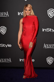 Tamar Braxton slipped into a slinky red Michael Costello one-sleeve gown for the InStyle and Warner Bros. Golden Globes party.