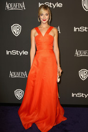 Caitlin Fitzgerald was a vision in a vivid-orange V-neck gown at the InStyle and Warner Bros. Golden Globes party.