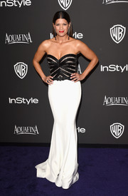 Andrea Navedo went for sexy glamour in a figure-hugging strapless gown at the InStyle and Warner Bros. Golden Globes party.