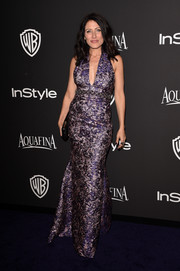 Lisa Edelstein was a head turner at the InStyle and Warner Bros. Golden Globes party wearing this figure-hugging halter gown in opulent purple brocade.