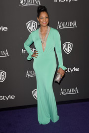 Garcelle Beauvais dressed up her curves in a slinky mint-green gown with a deep-V neckline for the InStyle and Warner Bros. Golden Globes party.