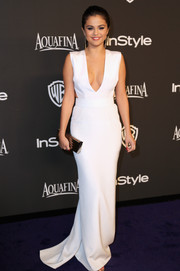 Selena Gomez made a very mature and alluring choice with this plunging white Kaufmanfranco gown for the InStyle and Warner Bros. Golden Globes party.