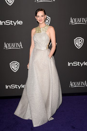 Jess Weixler looked opulent in a taupe racer-neckline jacquard gown at the InStyle and Warner Bros. Golden Globes party.