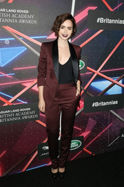Lily Collins was androgy-chic in a burgundy pantsuit by Burberry during the Britannia Awards.