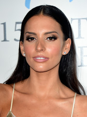 Genesis Rodriguez wore her hair long and straight with a center part when she attended the Latin Grammy Person of the Year event.