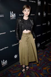 Lily Collins attended the 'Fast Times at Ridgemont High' closing night wearing black peep-toe heels, an olive-green skirt, and a leather jacket.