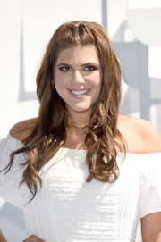 Molly Tarlov wore a very cute wavy half-up 'do when she attended the MTV Movie Awards.
