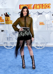 Hailee Steinfeld flashed some bra in a sheer olive-green ruffle blouse by Rodarte at the MTV Movie Awards.