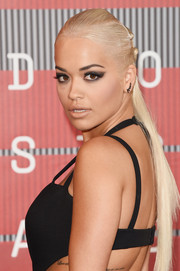Rita Ora went for an edgy beauty look with a smoky cat eye.