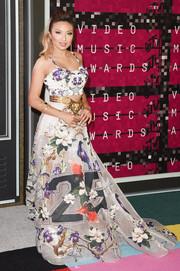 Jeannie Mai went for whimsical glamour in this floor-sweeping floral skirt during the MTV VMAs.
