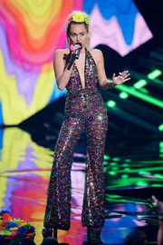 Miley Cyrus looked disco-ready in a fully embellished halter jumpsuit by The Blonds at the 2015 MTV VMAs.