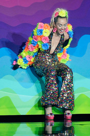 Miley Cyrus sealed off her colorful look with a pair of gemstone-encrusted platforms by Sophia Webster.