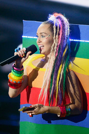 Miley Cyrus sported multicolored dreadlocks to match her rainbow outfit at the 2015 MTV VMAs.