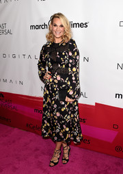 Molly Sims finished off her outfit with on-trend black lace-up heels.