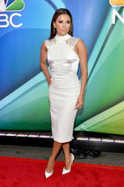 Eva Longoria flaunted her toned physique in a tight white sheath dress during the NBC Upfront Presentation.