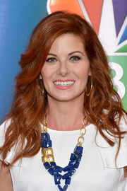 Debra Messing channeled the '70s with this feathered flip at the NBC Upfront Presentation.