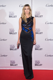 Still super slim in the early stages of pregnancy, Ivanka Trump wore a black Pamella Roland column dress with a sequined, embroidered, sheer-panel bodice for the New York City Ballet Fall Gala.