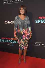 Gayle King went all out with the colors, pairing her floral frock with hot-pink ankle-tie pumps.