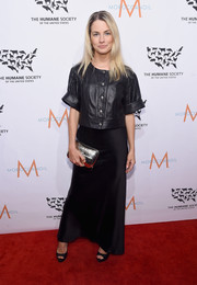 Amanda Hearst balanced out her edgy top with a delicate black satin skirt.