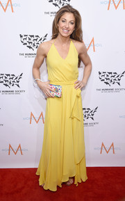Dylan Lauren was a drop of sunshine in a yellow wraparound halter gown during the 2015 to the Rescue! New York Gala.