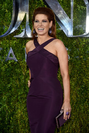 Debra Messing did matchy-matchy so elegantly with this purple satin clutch and halter dress combo at the Tony Awards.