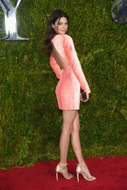 Kendall Jenner put plenty of skin on display in a backless pink mini dress by Calvin Klein at the Tony Awards.