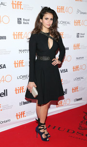 Nina Dobrev put on a cleavage-y display in a Versace cutout LBD during the 'Final Girls' photocall at TIFF.
