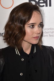 Ellen Page attended the TIFF premiere of 'Into the Forest' wearing a short wavy 'do.