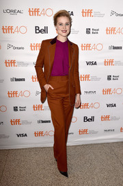 Evan Rachel Wood channeled the '70s in a rust-colored Gucci pantsuit at the TIFF premiere of 'Into the Forest.' The fuchsia blouse provided a striking color contrast.