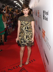 Kate Mara gleamed in a gold and black mixed-pattern cocktail dress by Valentino at the TIFF premiere of 'The Martian.'