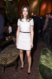 Alison Brie looked youthful and pretty in a short-sleeve white mini dress with black piping during the after-party for 'Sleeping with Other People.'