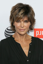 Lisa Rinna topped off her look with her usual layered razor cut when she attended the 2015 Tribeca Film Festival kickoff reception.