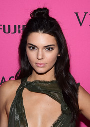 Kendall Jenner kept her beauty look low-key with pale pink lipstick.