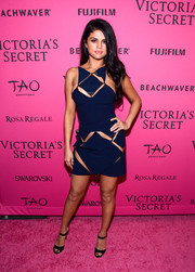 Selena Gomez blended in quite well at the Victoria's Secret fashion show in this racy blue cutout mini by Mugler.