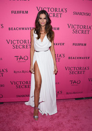 Izabel Goulart channeled her inner goddess in a draped white Grecian gown with a hip-grazing slit for the Victoria's Secret fashion show after-party.