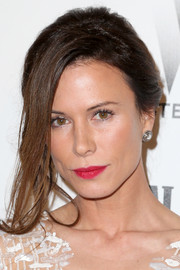 Rhona Mitra looked dramatic  at the Weinstein Company and Netflix Golden Globes party wearing this loose updo with bangs hanging to one side.