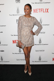 Aisha Tyler went for a leggy look in a beaded nude Aiisha mini dress during the Weinstein Company and Netflix Golden Globes party.